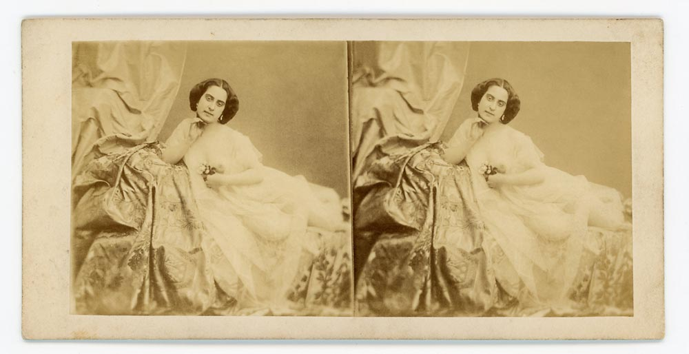 Vintage stereo card portrait of a woman reclining