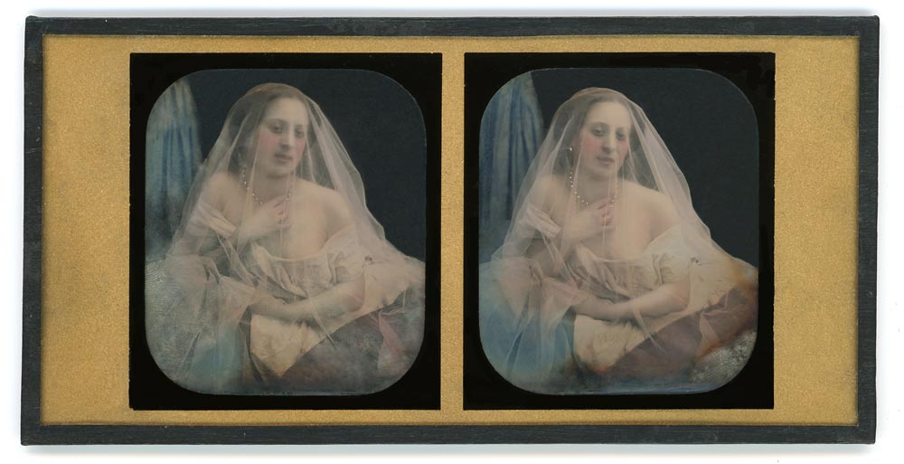 Stereo daguerreotype portrait of a woman in with a veil covering her face