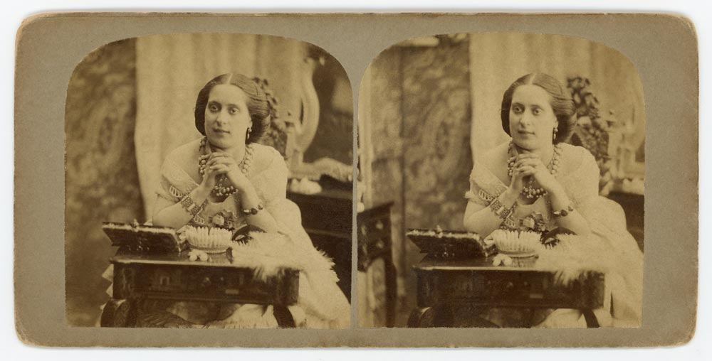 Vintage stereo card of a woman at a desk