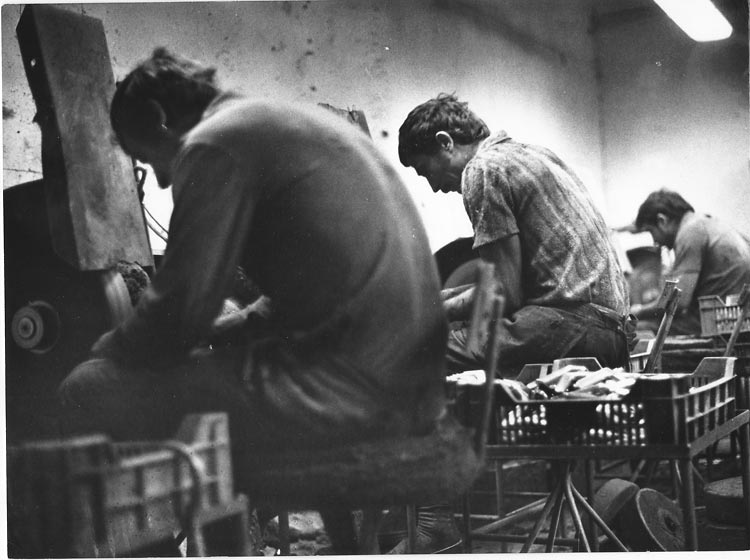 Gelatin silver print of men working in a factory