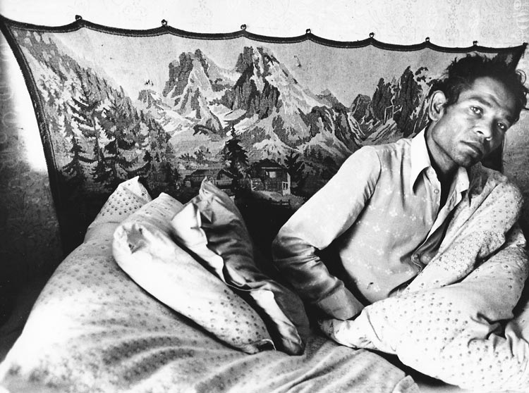 Gelatin silver print of Roma man in bed