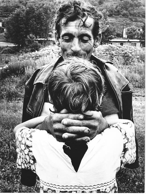 Gelatin silver print of Roma family hugging