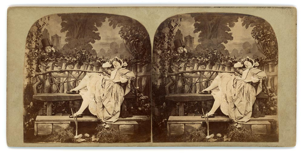 Vintage stereo view of a man in a top hat admiring a woman on a bench