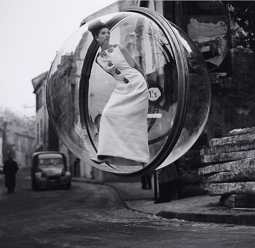 Fashion model floating in a bubble over Paris street