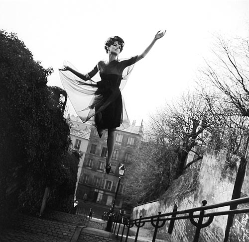 Fashion model flying over Paris street